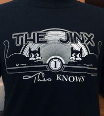 Theo Knows… The Jinx T-Shirt (Joe Silkie)